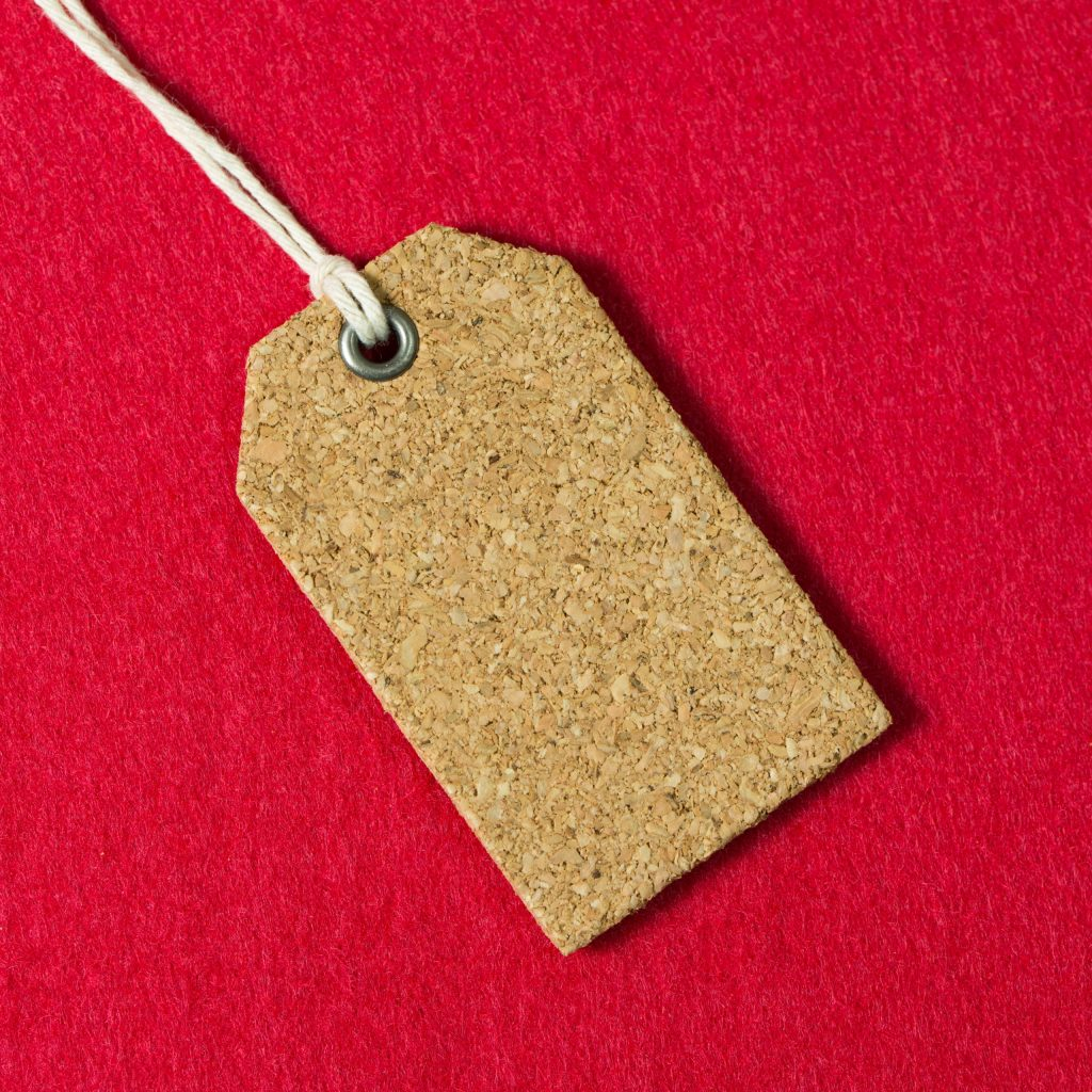 Blank price tag or gift tag on red background